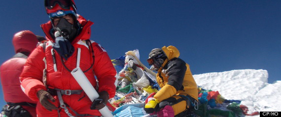 Shriya Shah-Klorfine (foreground), of Toronto, is shown at the summit of Mount Everest. The body of the Canadian woman who died while returning from the summit of Mount Everest is one step closer to being evacuated from the mountain. THE CANADIAN PRESS/ho-Utmost Adventure Trekking Pvt. Ltd.