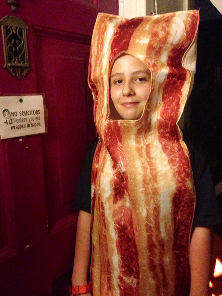 kid wrapped in bacon