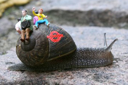 Inner City Snail art by London artist Slinkachu.