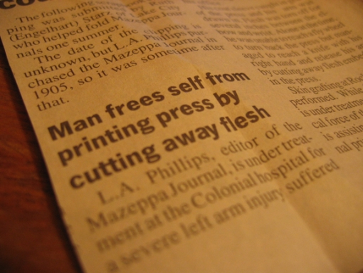 man-frees-self-from-printing-press